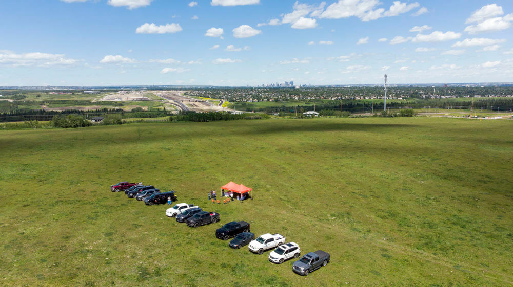 Aerial photo of site with cars Alpine Park
