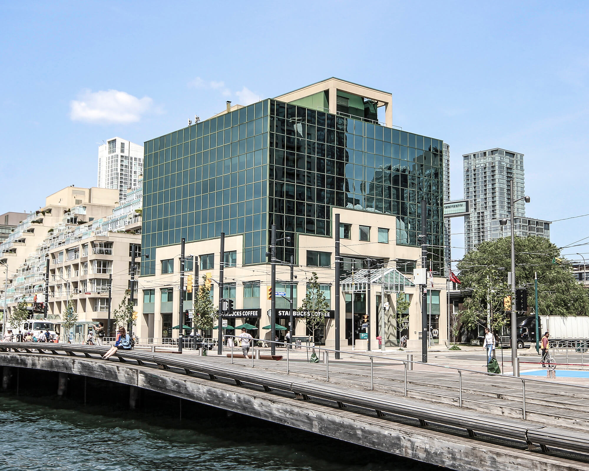 image of the waterfront Spadina Quay Office Complex - 10 Lower Spadina Ave. with people walking along the lake shore