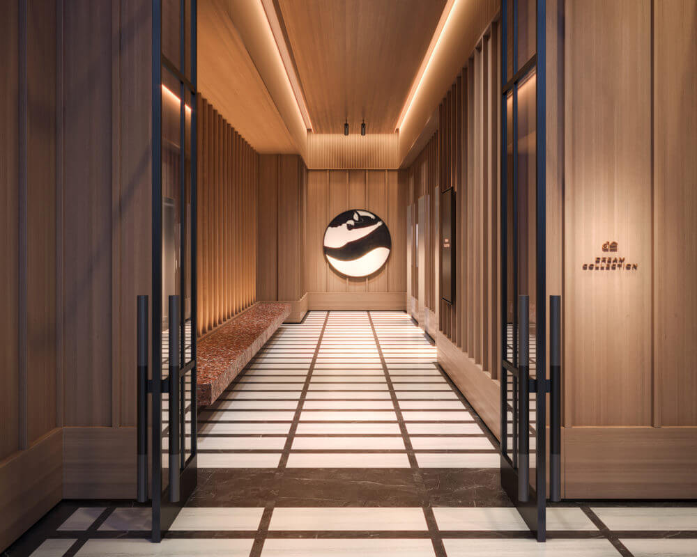 Rendering of lobby of building two doors open to a marble floor and warm wood walls with two elevators to the right.