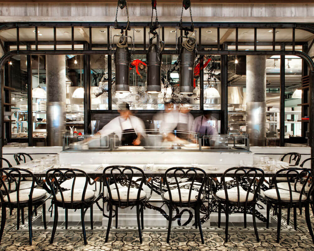 Interior of Cluny Bistro & Boulangerie with two chefs working