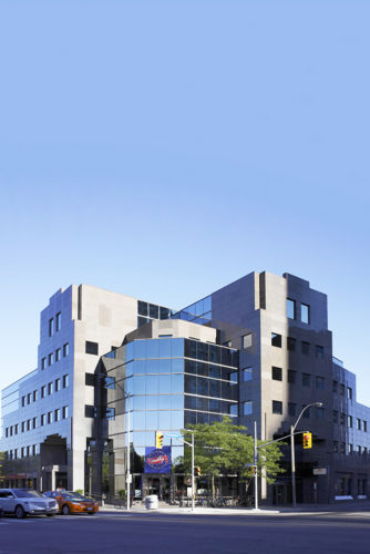 Front view of 425 Bloor Street, a mid-height glass building in Toronto