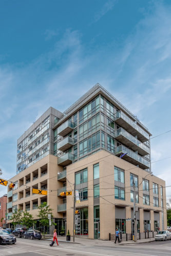 Side view of 639 Queen Street East, a mid-rise loft building in Toronto