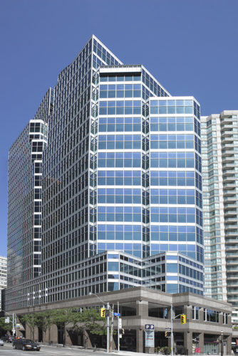 Front view of 655 Bay Street, a tall glass building in Toronto