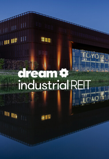 Evening shot of Ede, Netherlands Dream Industrial building with Dream Industrial REIT logo overlay in white.