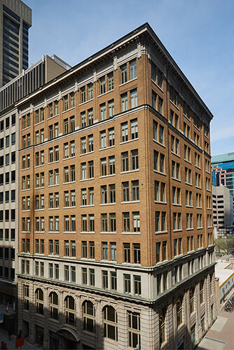 Drone image with the sun shining on Dream Office's 357 Bay Street building.